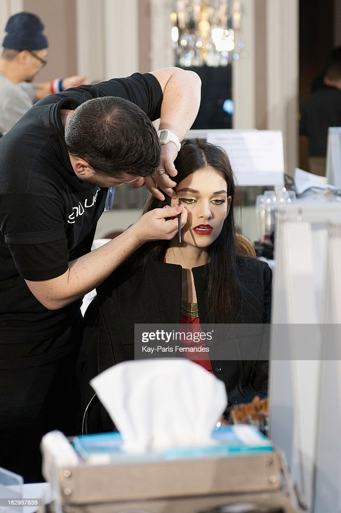 A model works backstage at the Tsumori Chisato Fall/Winter 2013 Ready-to-Wear show as part of Paris Fashion Week at The Hotel Westin on March 2, 2013 in Paris, France.