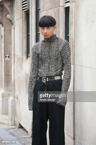 Model Xander Ang wears an Issey Miyake top Commes des Garcons trousers and a vintage belt on day 1 of London Collections Men on June 9 2017 in Paris...