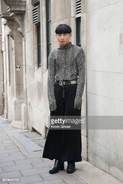 Model Xander Ang wears an Issey Miyake top Commes des Garcons trousers Balenciaga shoes and a vintage belt on day 1 of London Collections Men on June...