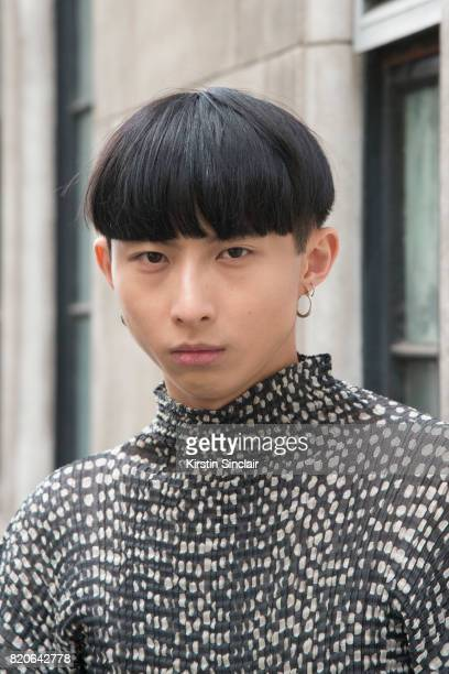 Model Xander Ang wears an Issey Miyake top on day 1 of London Collections Men on June 9 2017 in Paris France