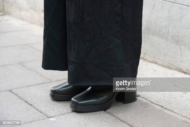 Model Xander Ang wears Commes des Garcons trousers and Balenciaga shoes on day 1 of London Collections Men on June 9 2017 in Paris France