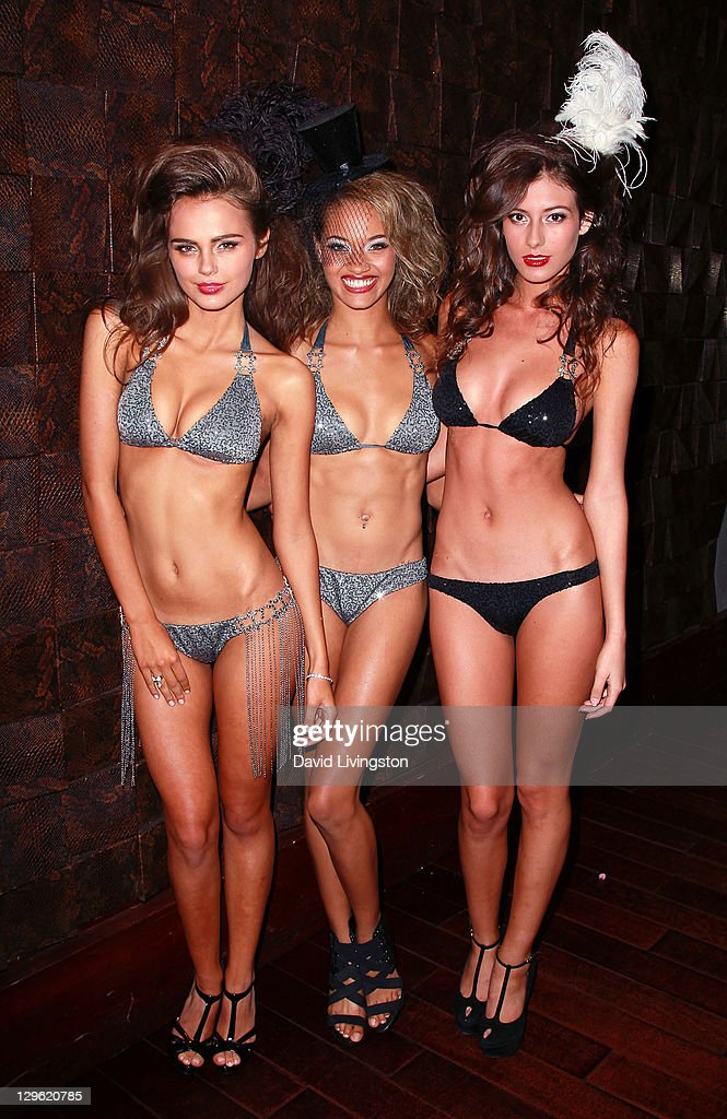 Model Xenia Deli (L) and models pose at Beach Bunny Swimwear's celebration of LA Fashion Week at Eden on October 18, 2011 in Los Angeles, California.
