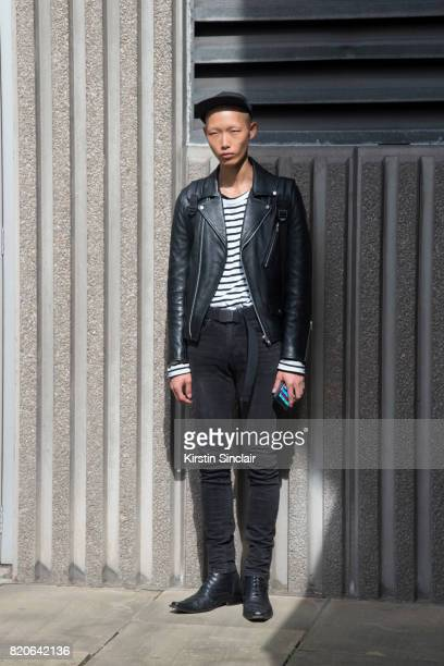 Model Xu wears H and M shorts and everything else vintage on day 1 of London Collections Men on June 9 2017 in Paris France
