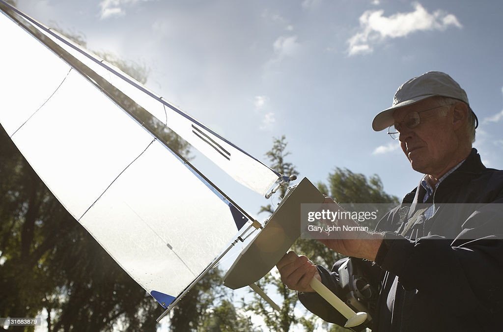 Model yacht owner admires boat : Stock Photo
