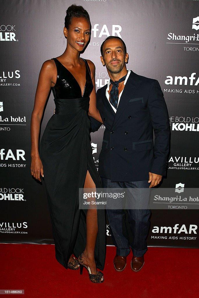 Model Yasmin Warsame (L) and Toufik Sarwa attend amfAR Cinema Against AIDS TIFF 2012 during the 2012 Toronto International Film Festival at Shangri-La Hotel on September 7, 2012 in Toronto, Canada.