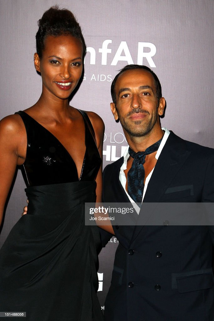 Model <a gi-track='captionPersonalityLinkClicked' href=/galleries/search?phrase=Yasmin+Warsame&family=editorial&specificpeople=228756 ng-click='$event.stopPropagation()'>Yasmin Warsame</a> (L) and Toufik Sarwa attend amfAR Cinema Against AIDS TIFF 2012 during the 2012 Toronto International Film Festival at Shangri-La Hotel on September 7, 2012 in Toronto, Canada.