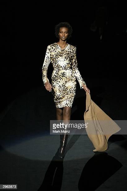 Model Yasmin Warsame walks down the runway at the Bill Blass Fall 2004 Fashion show during Olympus Fashion Week at Bryant Park February 10 2004 in...