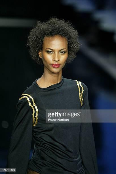 Model Yasmin Warsame walks down the runway at the Cynthia Rowley Fall 2004 Fashion show during Olympus Fashion Week at the Promenade in Bryant Park...