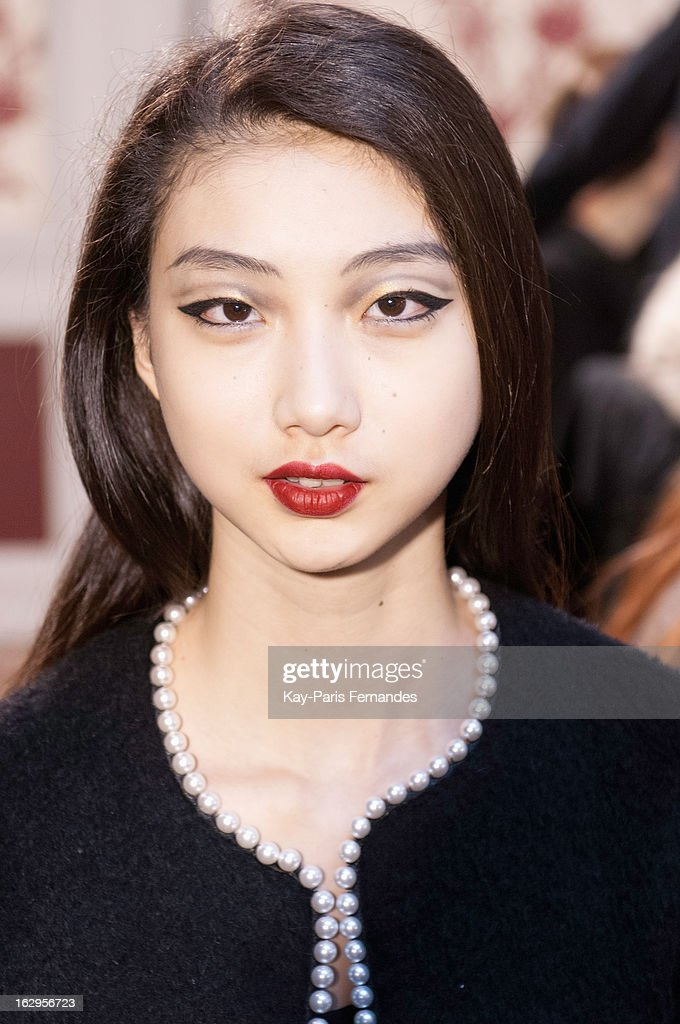 Model Yue Ning works backstage at the Tsumori Chisato Fall/Winter 2013 Ready-to-Wear show as part of Paris Fashion Week at The Hotel Westin on March 2, 2013 in Paris, France.