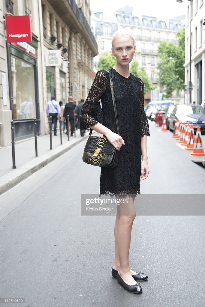 Model Yulia Lobova wears a Dolce and Gabbana dress, Celine bag and Chanel shoes on day 4 of Paris Collections: Womens Haute Couture on July 04, 2013 in Paris, France.