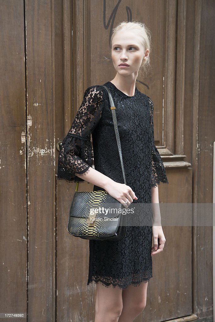 Model Yulia Lobova wears a Dolce and Gabbana dress, Celine bag on day 4 of Paris Collections: Womens Haute Couture on July 04, 2013 in Paris, France.
