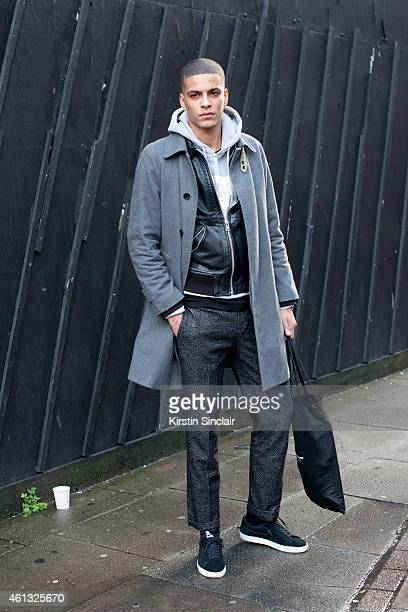 Model Zakaria Khiare wearing a Soulland coat and trousers Nike trainers and a Woodward jacket on day 2 of London Collections Men on January 10 2015...