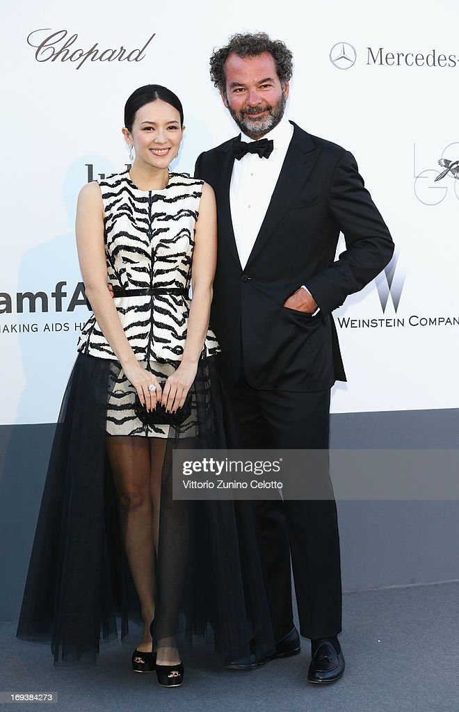 Model Zhang Ziyi and Chairman and Creative Director of The Moncler Group Remo Ruffini attend amfAR's 20th Annual Cinema Against AIDS during The 66th Annual Cannes Film Festival at Hotel du Cap-Eden-Roc on May 23, 2013 in Cap d'Antibes, France.