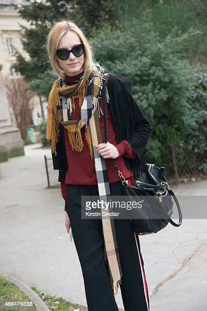 Model Zlata Manga wears a Burberry scarf Marc Jacobs bag and Prada top on day 7 of Paris Collections Women on March 09 2015 in Paris France