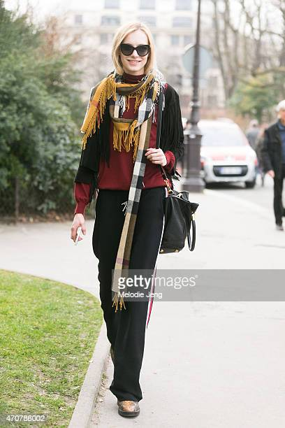Model Zlata Semenko exits the Giambattista Valli show at Grand Palais in a Burberry scarf on Day 7 of Paris Fashion Week FW15 on March 9 2015 in...