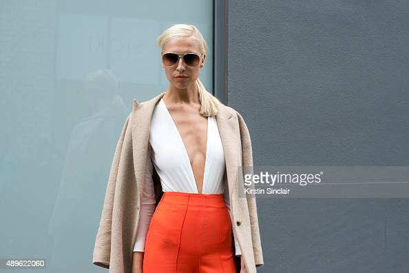 Model Zoe Basia wears an AQ/AQ leotard and trousers Massimo Dutti jacket and Ray Ban sunglasses on day 5 during London Fashion Week Spring/Summer...