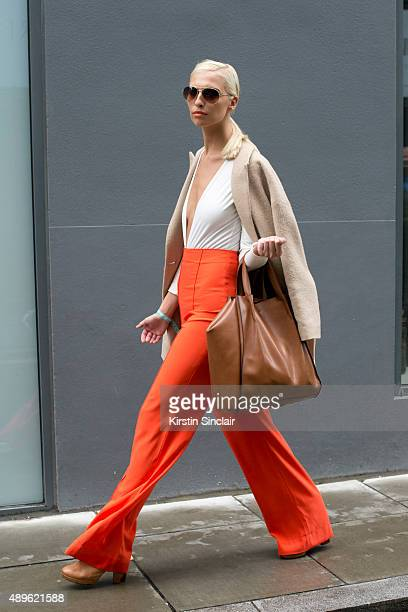 Model Zoe Basia wears an AQ/AQ leotard and trousers Massimo Dutti jacket Zara bag and Ray Ban sunglasses on day 5 during London Fashion Week...