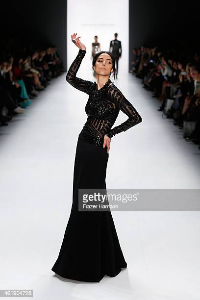Model Zoe Helali walks the runway at the Guido Maria Kretschmer show during the MercedesBenz Fashion Week Berlin Autumn/Winter 2015/16 at Brandenburg...