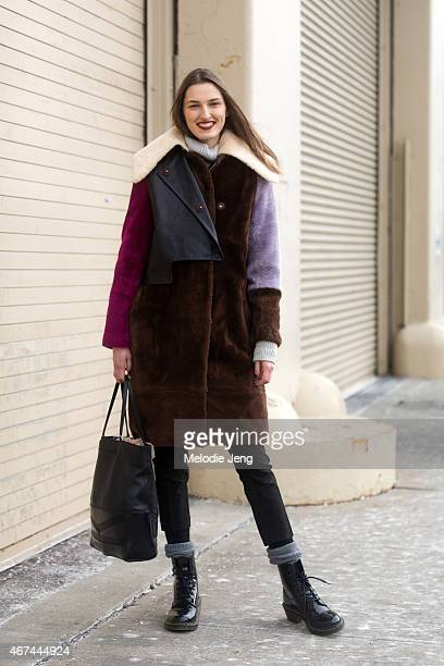 Model Zoe Huxford exits the 31 Phillip Lim show in a Phillip Lim coat and Dr Martens boots on Day 6 of New York Fashion Week Fall 2015 on February 16...