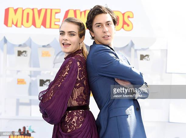 Model/actress Cara Delevingne and actor Nat Wolff attend The 2015 MTV Movie Awards at Nokia Theatre LA Live on April 12 2015 in Los Angeles California
