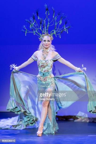 Model/Actress Dustin Quick walks the runway wearing a Marika Soderlund Robison design at the Metropolitan Fashion Week Closing Night Gala at Arcadia...