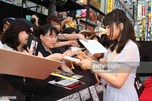 Model/actress Hinako Sakurai signs autograph for fans at the Japanese premiere of 'Transformers The Last Knight' at TOHO Cinemas Shinjuku on July 20...