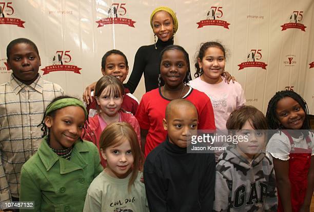 Model/Actress Yaya DaCosta and children from the Harlem Montessori School attend the StoryCorps Griot and Harlem YMCA 'Gathering Stories' event at...