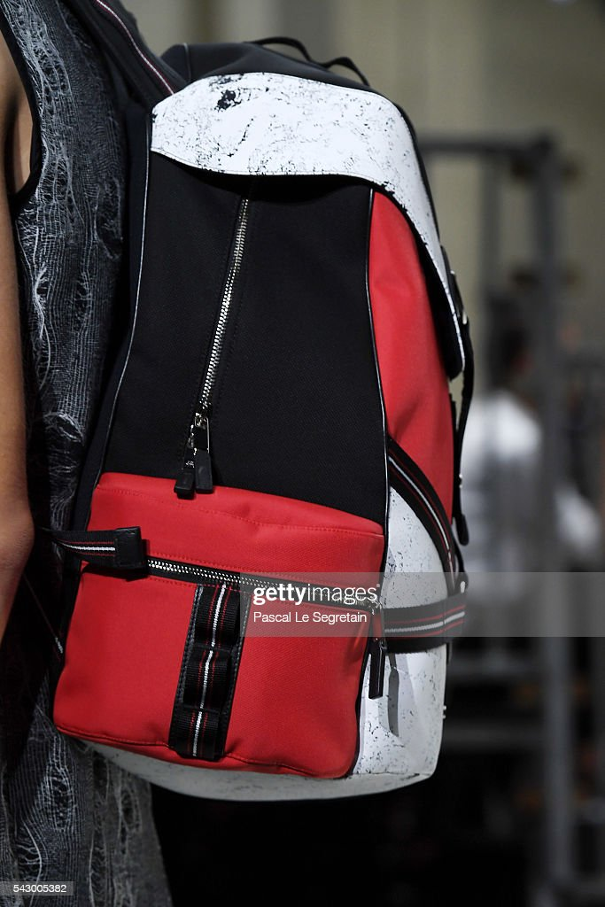 A model,bag detail, walks the runway during the Dior Homme Menswear Spring/Summer 2017 show as part of Paris Fashion Week on June 25, 2016 in Paris, France.