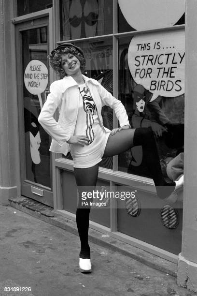 Modelled by Maggie Harris the white cotton zip jacket is worn with matching hot pants cotton vest with large 'icecream' motif and velvet cap The...