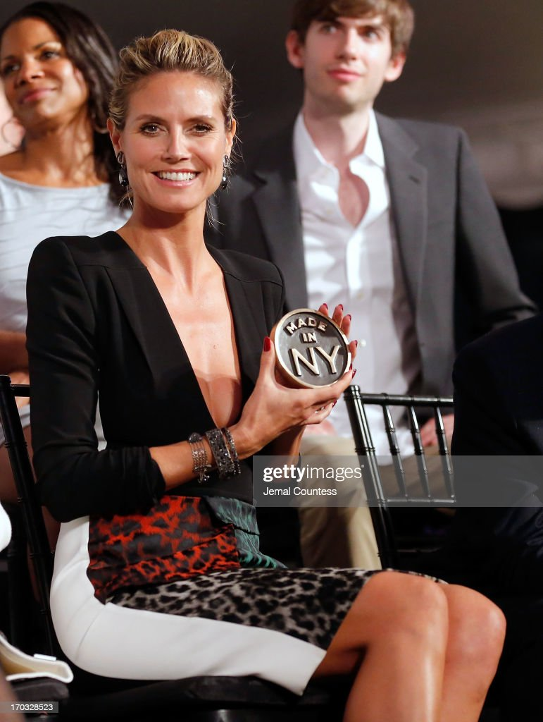 Model/media personality <a gi-track='captionPersonalityLinkClicked' href=/galleries/search?phrase=Heidi+Klum&family=editorial&specificpeople=178954 ng-click='$event.stopPropagation()'>Heidi Klum</a> poses with her 'Made In NY Award' at the 8th Annual 'Made In NY Awards' at Gracie Mansion on June 10, 2013 in New York City.