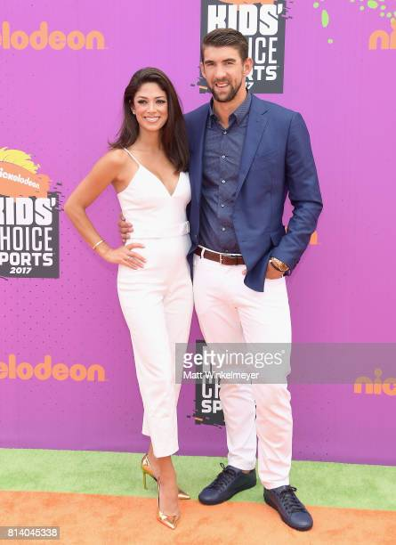 ModelMiss California USA 2010 Nicole Johnson and honoree Michael Phelps attend Nickelodeon Kids' Choice Sports Awards 2017 at Pauley Pavilion on July...