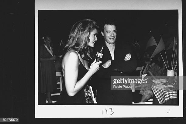 ModelMTV host Cindy Crawford holding mike as she interviews actor Tom Hanks at premiere party for the movie A League of Their Own at Tavern on the...