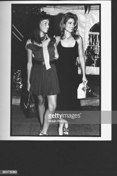 ModelMTV hostess Cindy Crawford posing w her arm around unident woman at premiere party for the movie A League of Their Own at Tavern on the Green...