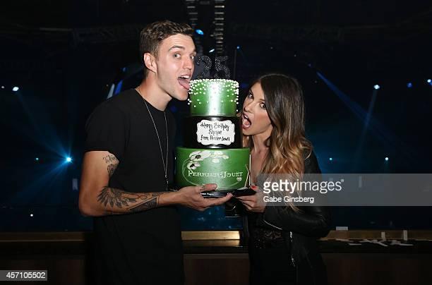 Model/musician Josh Beech and his wife actress Shenae GrimesBeech joke around with a birthday cake in celebration of GrimesBeech's upcoming birthday...
