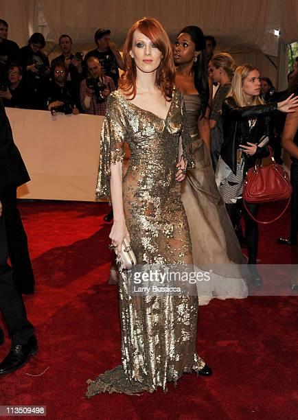 Model/musician Karen Elson and Jennifer Hudson attend the 'Alexander McQueen Savage Beauty' Costume Institute Gala at The Metropolitan Museum of Art...