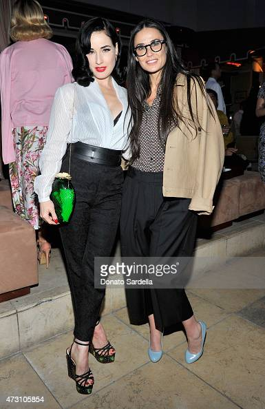 Model/performer Dita Von Teese and actress Demi Moore attend an intimate dinner hosted by Charlotte Olympia Dellal and Liz Goldwyn at The Sunset...