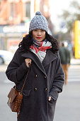 Model/Photographer Trese San Wong wears a Marc Jacobs coat and bag and vintage scarf in the East Village on November 22 2014 in New York City