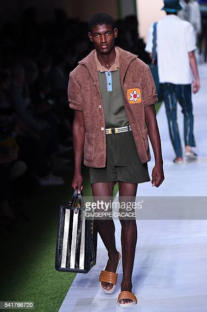 A modelpresents a creation for fashion house Fendi during the Men's Spring Summer 2017 fashion shows on June 20 2016 in Milan AFP PHOTO / GIUSEPPE...