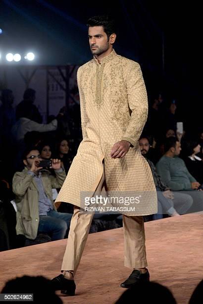 A modelpresents creations of designer Hassan Sheheryar Yasin at the Karachi Fashion Week men's in Karachi on December 27 2015 / AFP / RIZWAN TABASSUM