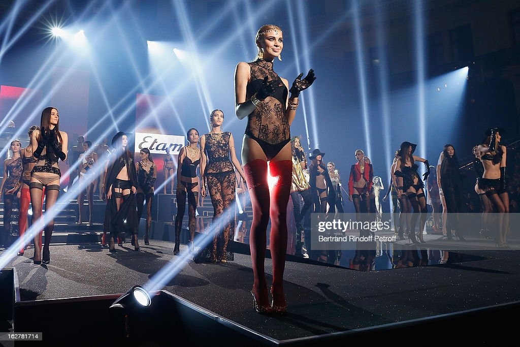 Models acknowledge applause following the Etam Live Show Lingerie at Bourse du Commerce on February 26, 2013 in Paris, France.