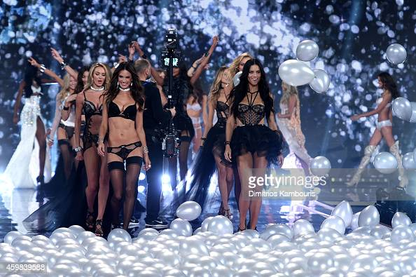 Models Adriana Lima and Alessandra Ambrosio walk the show finale of the 2014 Victoria's Secret Fashion Show at Earl's Court Exhibition Centre on...