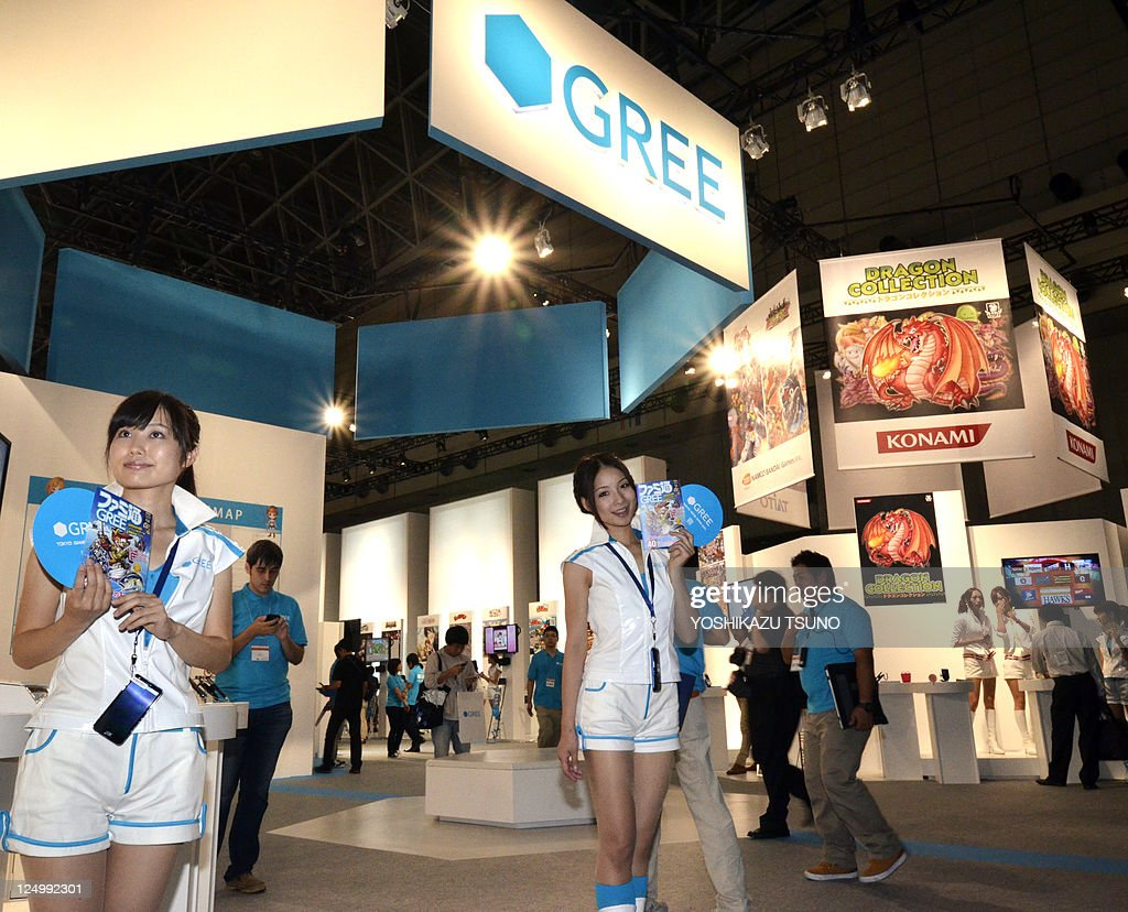 Models advertise products at the booth of Japan's mobile social networking service company Gree at the annual Tokyo Game Show in Chiba, suburban Tokyo, on September 15, 2011. Some 200 companies from 16 countries exhibited their latest video game hardwares and softwares at a four-day vent. AFP PHOTO / Yoshikazu TSUNO