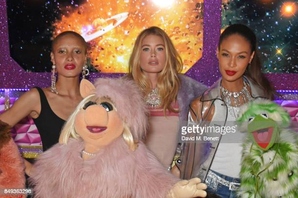 Models Adwoa Aboah Doutzen Kroes and Joan Smalls pose with Miss Piggy and Kermit The Frog at the LOVE magazine x Miu Miu party held during London...