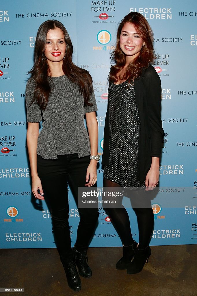 Models Amanda Faical and Emely Farg attend The Cinema Society & Make Up For Ever host a screening of 'Electrick Children' at IFC Center on March 4, 2013 in New York City.