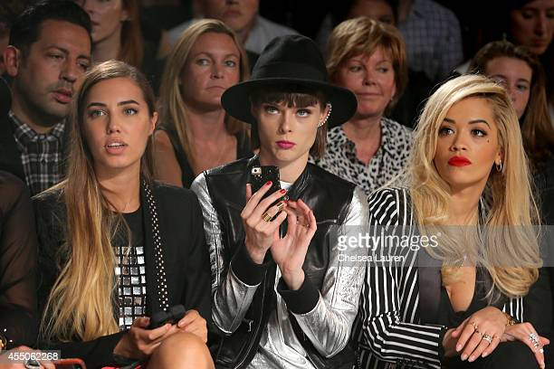 Models Amber Le Bon and Coco Rocha and singer Rita Ora sit front row at the Diesel Black Gold fashion show during MercedesBenz Fashion Week Spring...