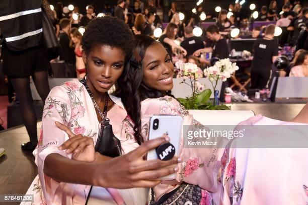 Models Amilna Estevao and Zuri Tibby pose for a selfie in Hair Makeup during 2017 Victoria's Secret Fashion Show In Shanghai at MercedesBenz Arena on...