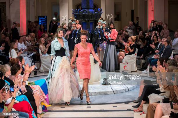 Models and Designer Anja Gockel acknowledge the applause of the guests at the end of Anja Gockel fashion show during MercedesBenz Berlin Fashion Week...