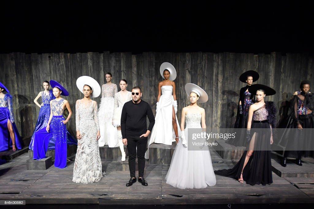 Models and designer Mehmet Korkmaz pose at the Mehmet Korkmaz presentation during Mercedes-Benz Istanbul Fashion Week September 2017 at Zorlu Center on September 13, 2017 in Istanbul, Turkey.