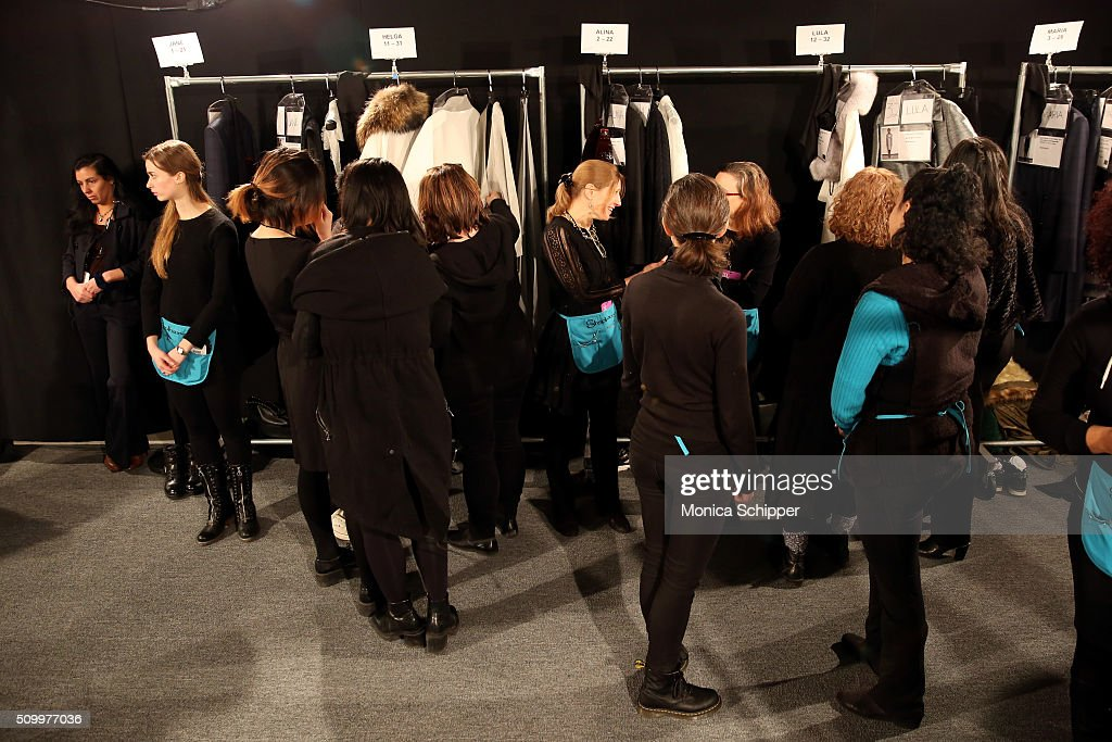 Models and stylists prepare backstage at Taoray Wang fashion show during Fall 2016 New York Fashion Week: The Shows at The Dock, Skylight at Moynihan Station on February 13, 2016 in New York City.