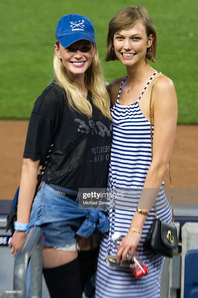 Models Anne Vyalitsyna (L) and Karlie Kloss attend the New York Mets vs New York Yankees game at Yankee Stadium on May 30, 2013 in New York City.